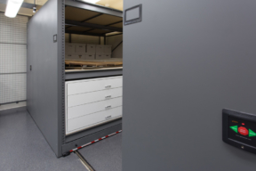 Museum Cabinets at Historic St. Mary's with large flat file drawers and upper shelving