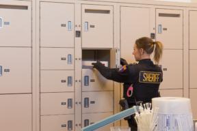 Deputies place packaged evidence into Pass through lockers