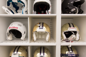 Helmet Football Equipment Stored on 4-Post Shelving with Dividers