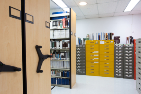 Library Shelving on Mechanical Assist High-Density Mobile Shelving