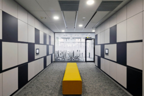 Graphic black and white lockers in a double sided locker bank. Smart Workplace RFID Lockers - Day-Use Lockers